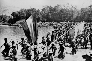 Ethiopian resistance fighters carrying giant Ethiopian flags, trek across the banks of the Omo river in Southern Ethiopia during the Second Italo Abyssinian war of 1935-1941 (Photo credit:  Ibiblio)