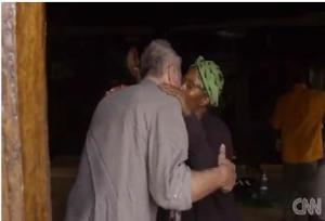 Maya Haile's mother Bizunesh greets her guest Anthony Bourdain in typical Ethiopian fashion (CNN)