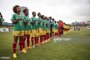 Members of the Ethiopian national team, Lucy, stand in unison as they sing the national anthem (Photo credit: Getty Images)