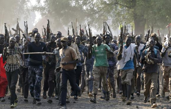 Rebel fighters gather in a village in Upper Nile State